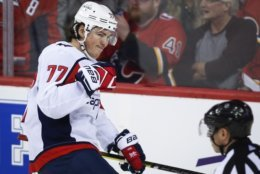 Washington Capitals' T.J. Oshie celebrates his goal during first-period NHL hockey game action against the Calgary Flames in Calgary, Alberta, Saturday, Oct. 27, 2018. (Jeff McIntosh/The Canadian Press via AP)