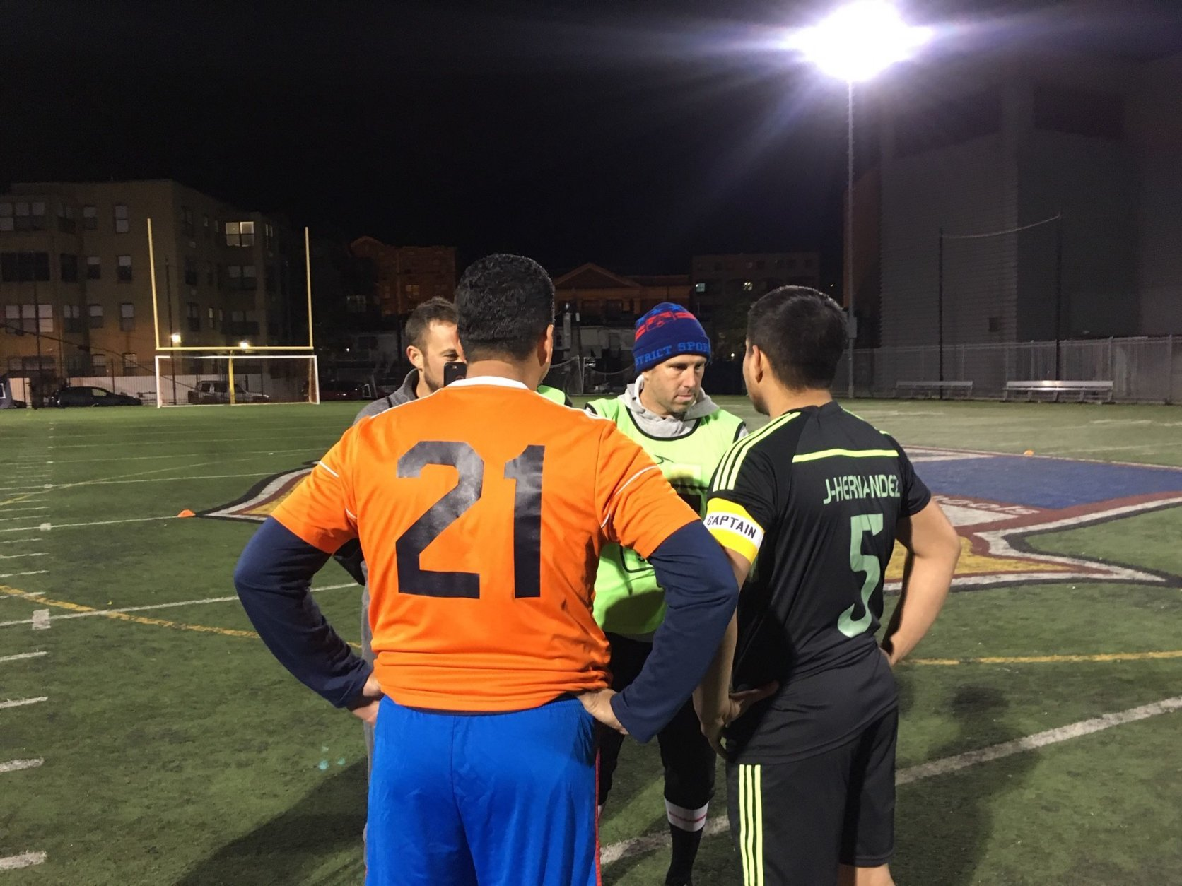 Team captains from Oyamel and Jaleo D.C. meet before the opening kick of this year's Copa final. (WTOP/Noah Frank)