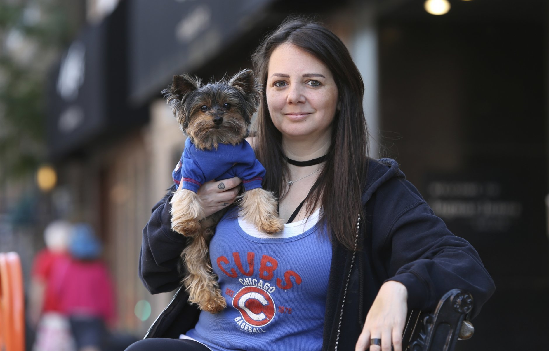Lauren Pestikas holds her dog Sambuca in Chicago on Aug. 1, 2018. Since starting treatments with ketamine infusions, she says she feels much better for a few weeks after each session. Her monthly infusions last about 45 minutes and cost $550 each. Pestikas struggled with depression and anxiety and made several suicide attempts before starting ketamine treatments earlier in the year. (AP Photo/Teresa Crawford)