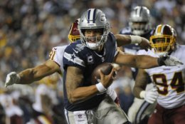 Washington Redskins linebacker Ryan Kerrigan (91) closes in on Dallas Cowboys quarterback Dak Prescott (4) forcing a fumble and a touchdown during the second half of an NFL football game, Sunday, Oct. 21, 2018 in Landover, Md. (AP Photo/Mark Tenally)
