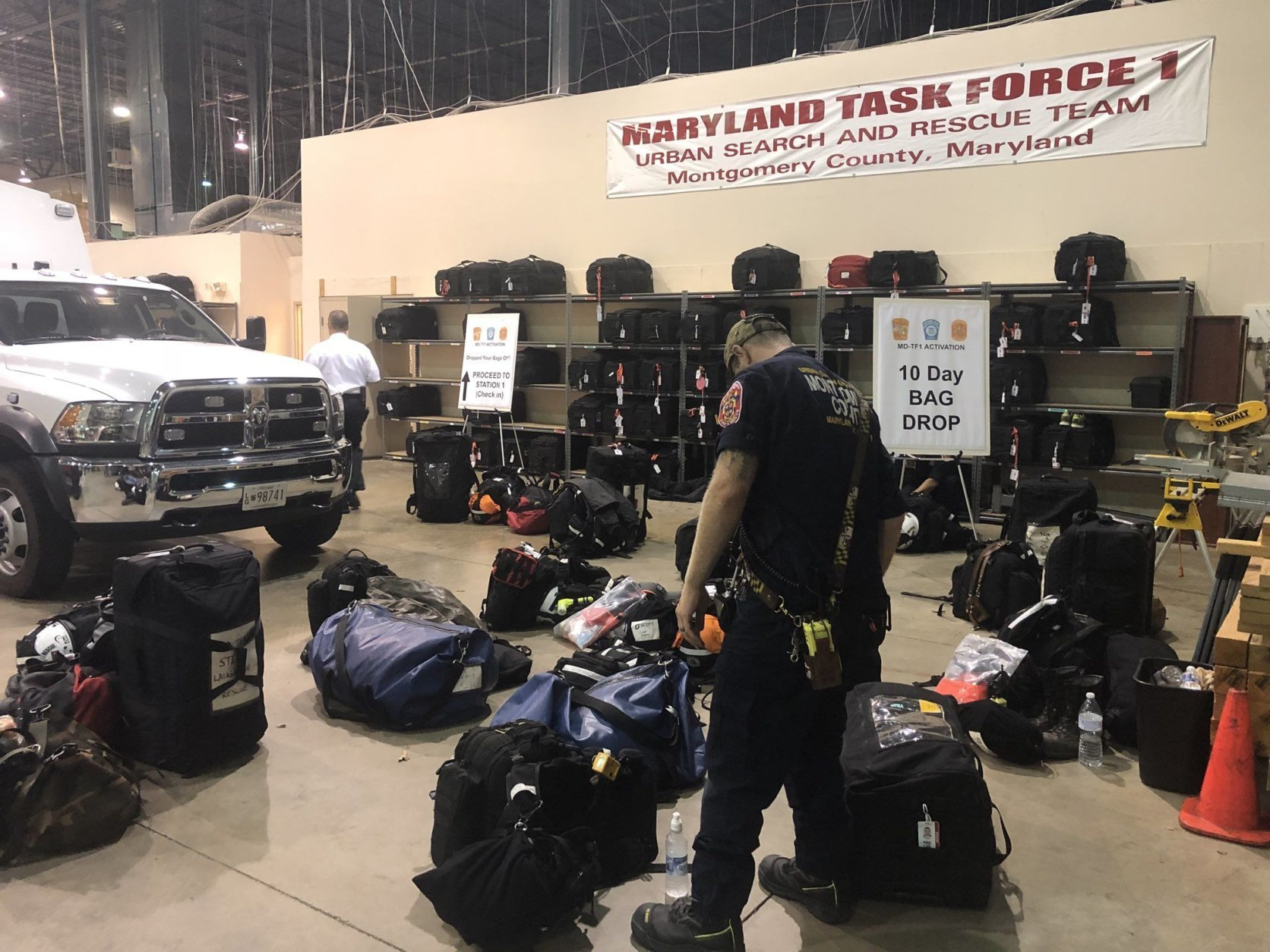 Sixteen search-and-rescue technicians with MD-TF1 were deployed from a staging warehouse in Montgomery County early Tuesday. (WTOP/Melissa Howell)