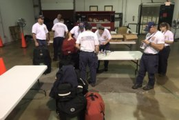 In Fairfax County, Virginia, two teams — each with 17 search and rescue personnel — readied for deployment early Tuesday. (WTOP/Neal Augenstein)