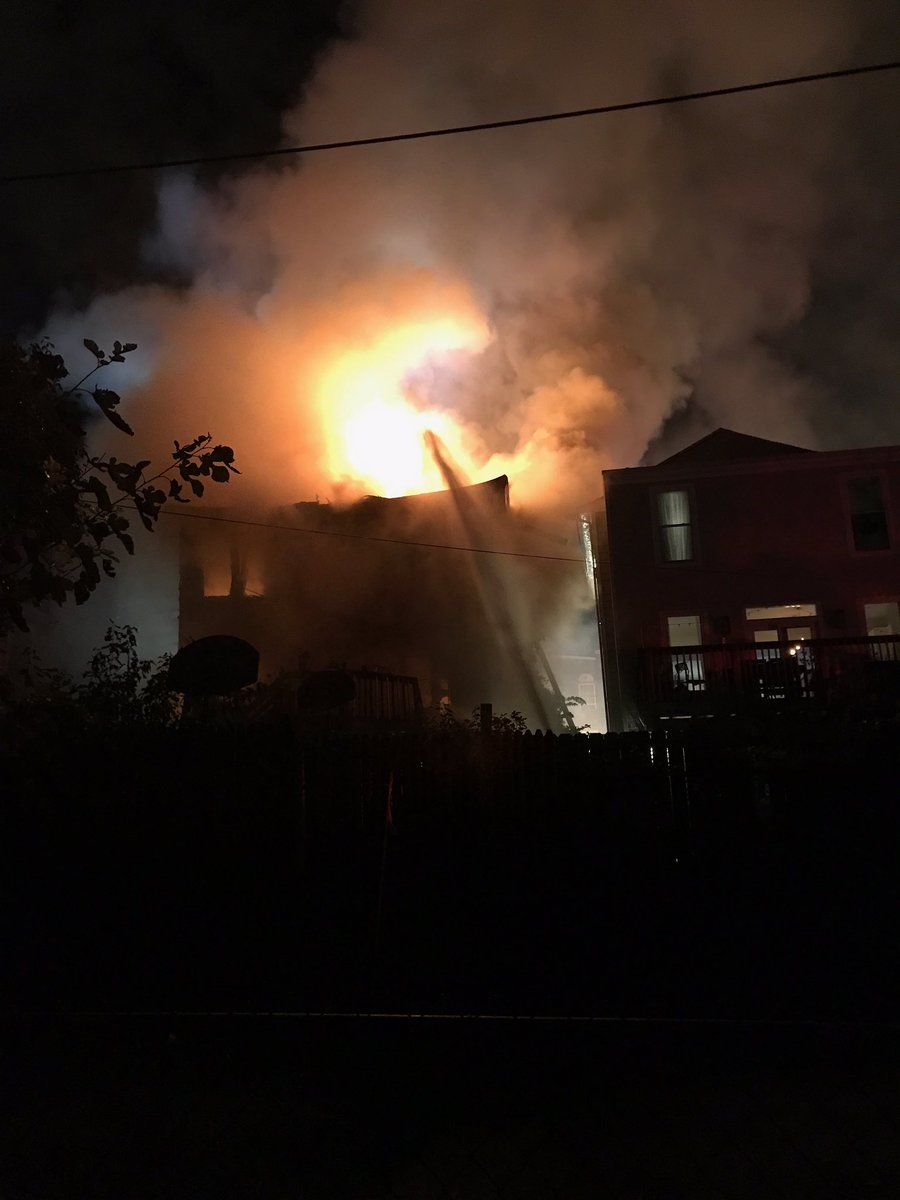 When D.C. Fire and EMS responded to the scene, they saw fire through the roof of the home. (Courtesy D.C. Fire and EMS)