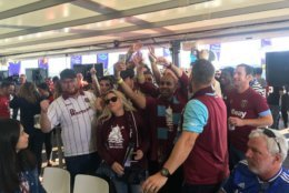 A group of West Ham fans celebrate their upset win over Manchester United at the Premier League Fanfest at Capitol View. (WTOP/Noah Frank)