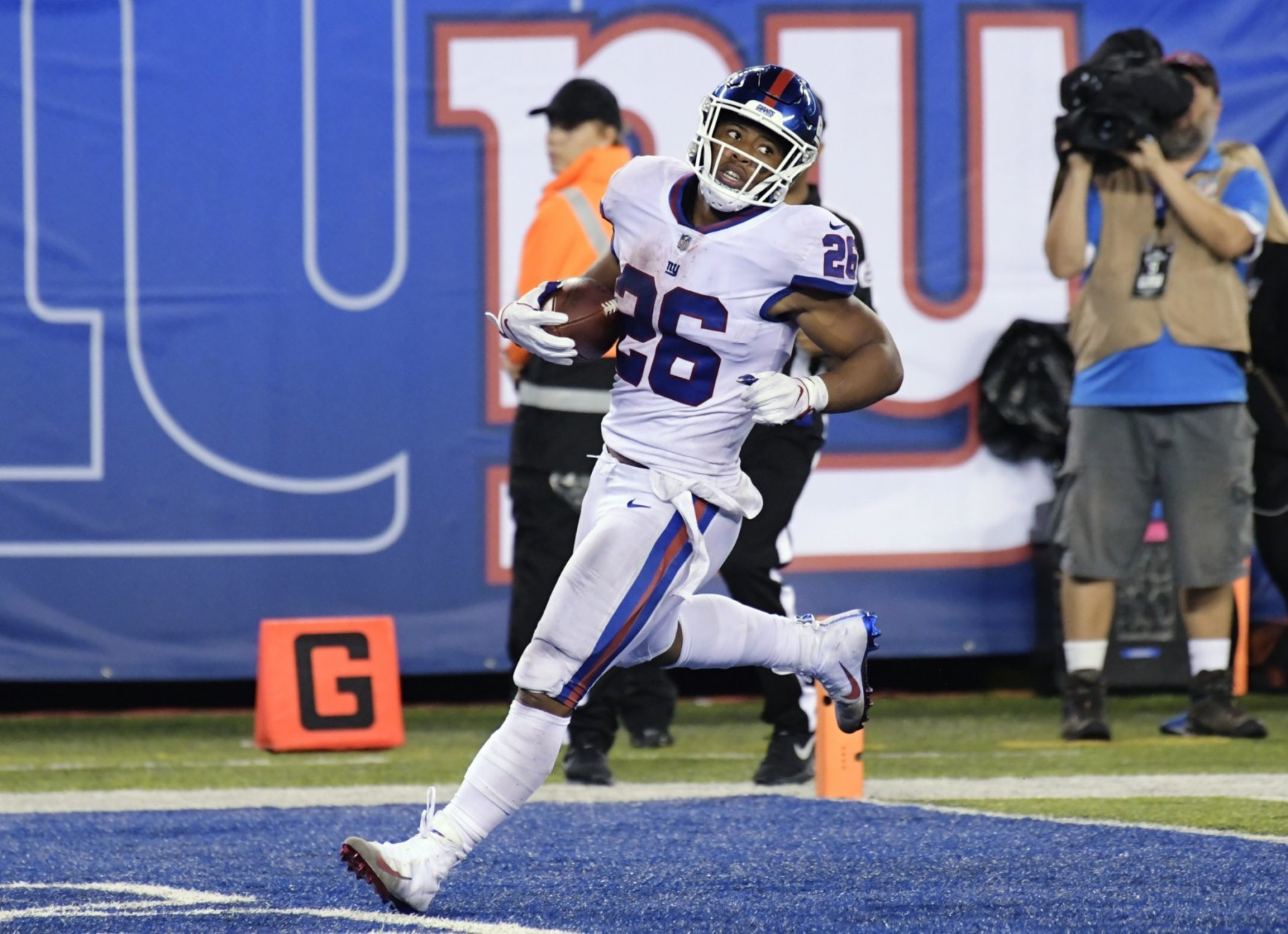 New York Giants running back Saquon Barkley runs in for a touchdown during the second half of the team's NFL football game against the Philadelphia Eagles on Thursday, Oct. 11, 2018, in East Rutherford, N.J. (AP Photo/Bill Kostroun)