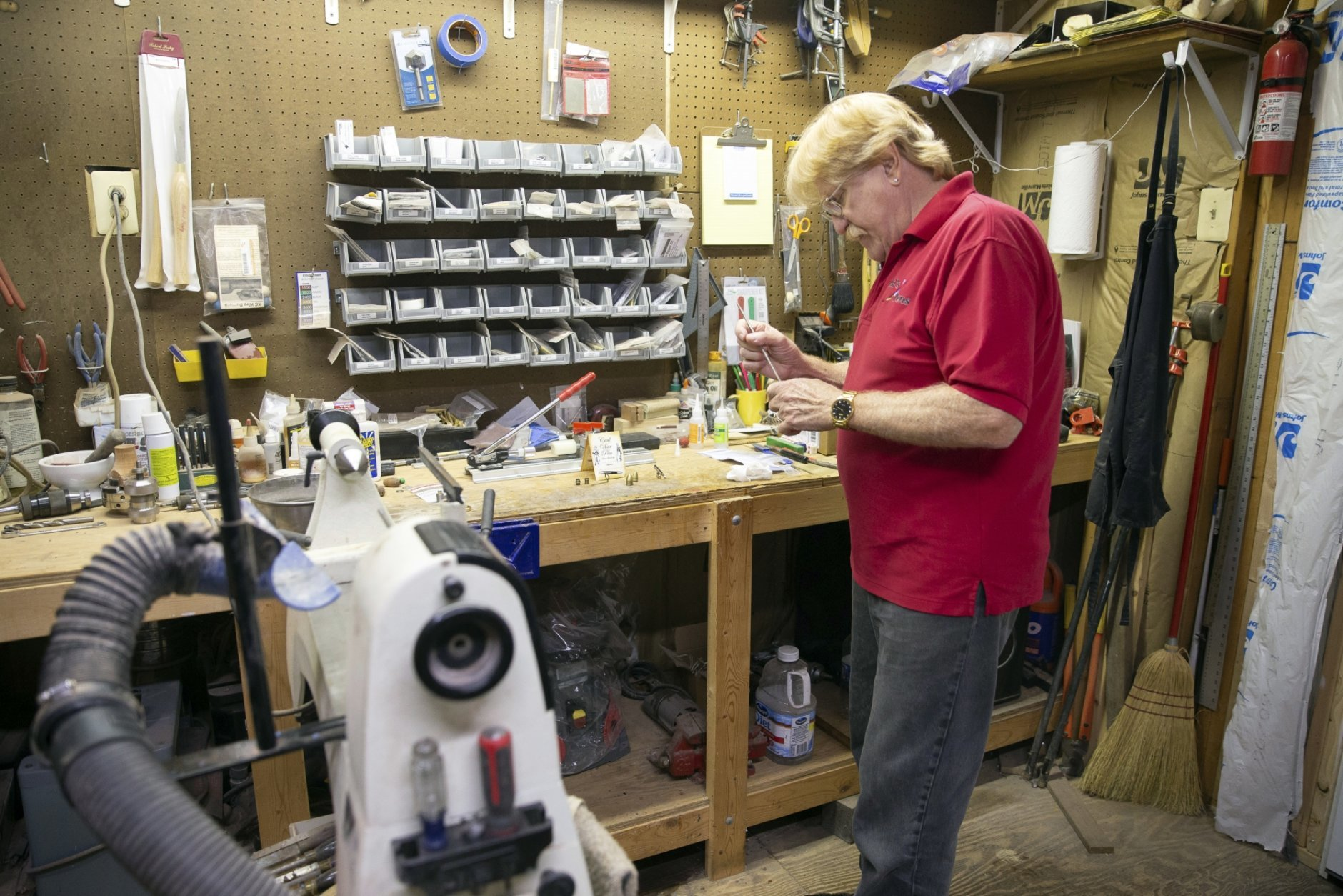 Ed Seyfried, owner of Ed's Pens, works on a pen at his home in King George, Va. on Sept. 20, 2018. Seyfried uses materials including wood, acrylic, metal, horn and bone to make the pens.  (Mike Morones/The Free Lance-Star via AP)