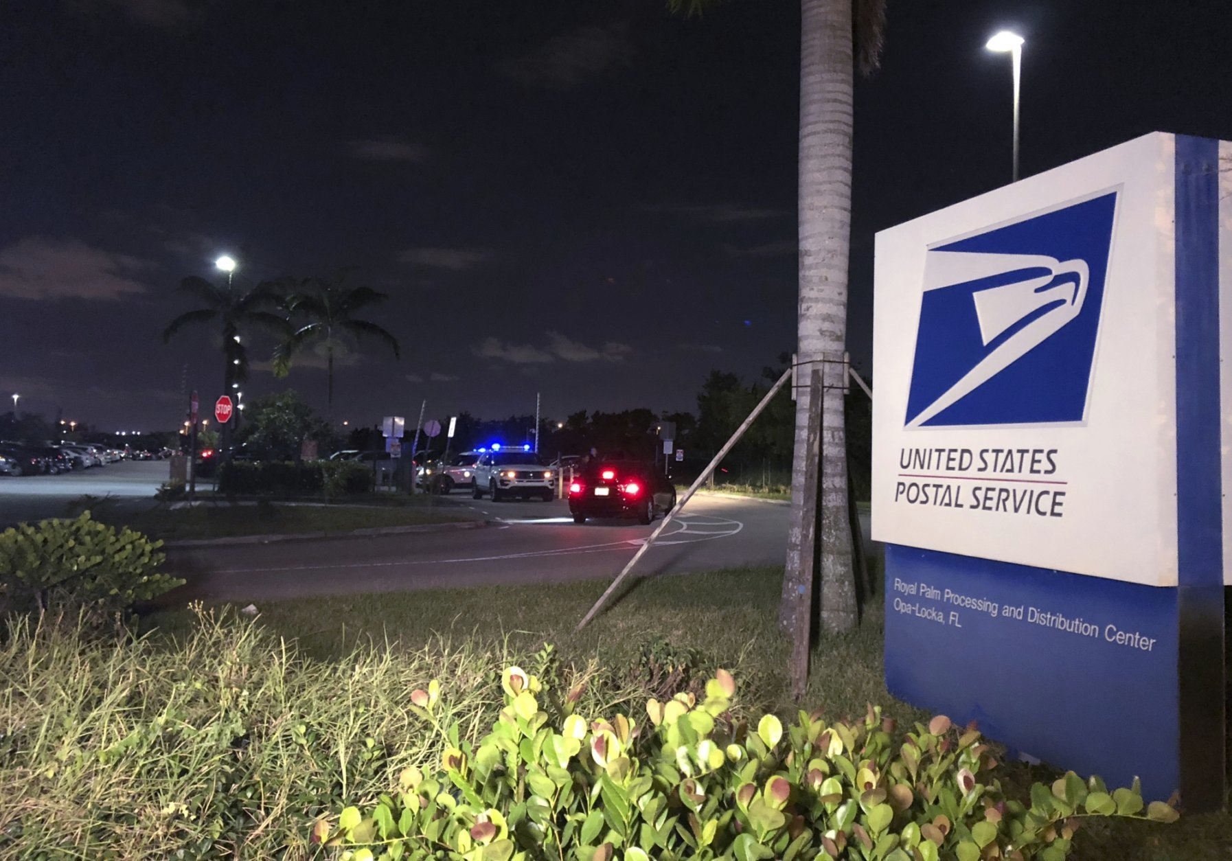 Postal service police screen employees entering the Royal Palm processing and Distribution Center, Thursday, Oct. 25, 2018 in Opa-locka, Fla.  A law enforcement source tells The Associated Press that Miami-Dade police have gone to the mail-sorting facility in Opa-Locka, Florida, at the request of the FBI in connection with the suspicious package investigation. The source says it was a precautionary measure.(AP Photo/Josh Replogle)
