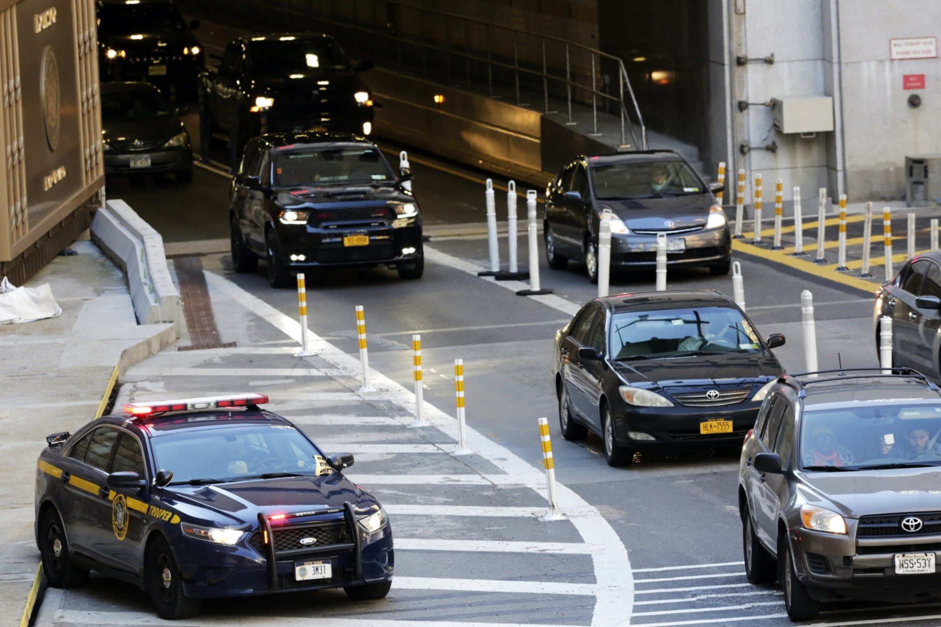 A New York state police car is staged at the Hugh Carey Tunnel, Thursday, Oct. 25, 2018, in New York. Gov. Andrew Cuomo has increased security at vital infrastructure locations following the delivery of a series of pipe bombs to New Yorkers. (AP Photo/Mark Lennihan)