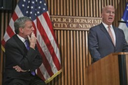 Mayor Bill deBlasio, left, listens as Police Commissioner James P. O'Neil speaks during a news conference on the latest in the package bomb investigation, Thursday Oct. 25, 2018, in New York. (AP Photo/Bebeto Matthews)