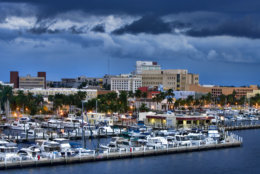 Overlooking downtown Fort Myers, Florida with the yacht basin in the foreground.  Typical summer late afternoon with storm clouds lingering.