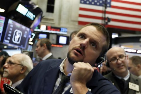 Asian shares mostly lower despite US markets rally