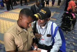 """He's a hero,"" Washington Informer photographer Roy Lewis said of U.S. Marine Corps Captain Trey Gregory, who ran into the burning Arthur Capper Senior Apartment building to help evacuate residents. (WTOP/Kristi King)"
