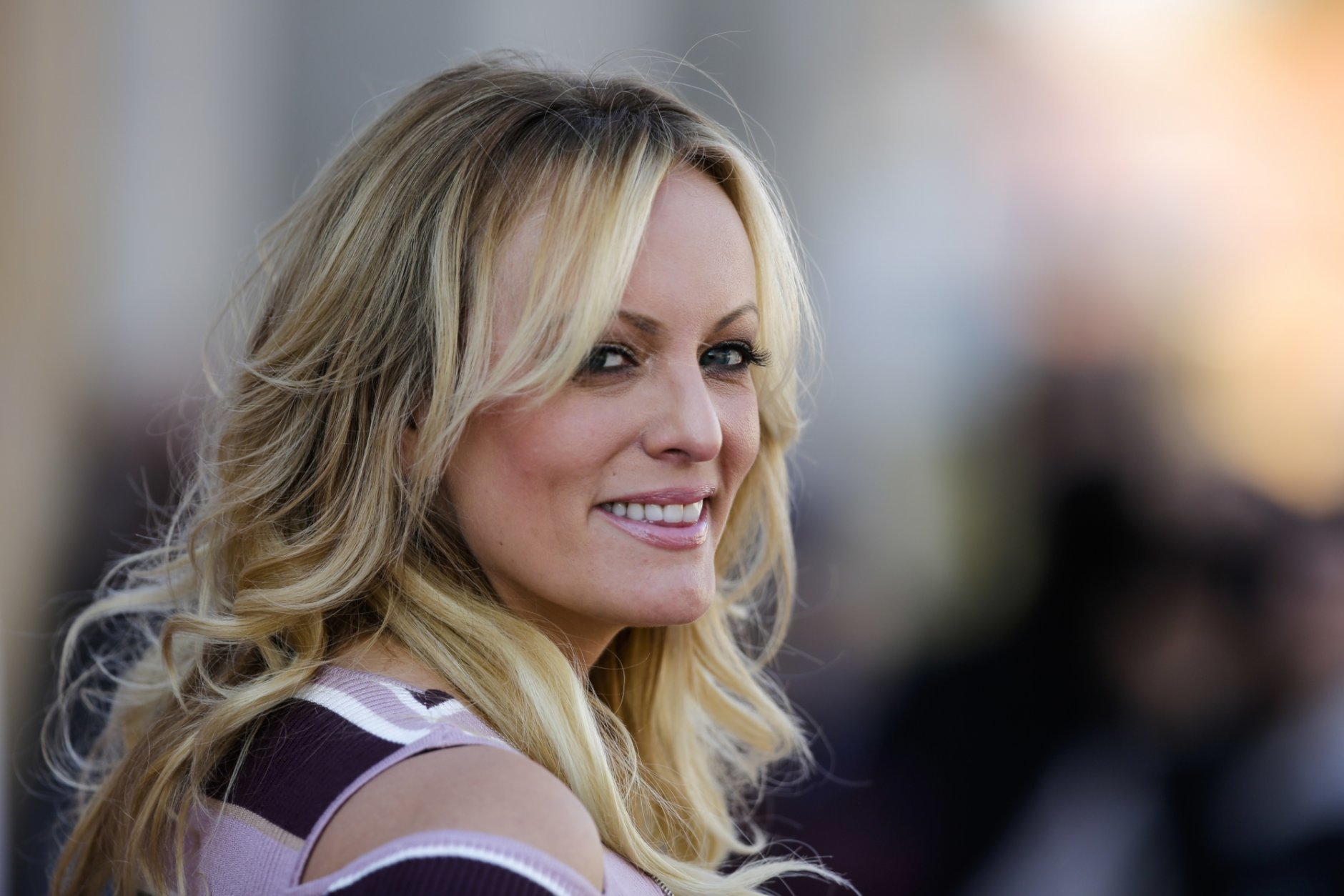 Adult film actress Stormy Daniels attends the opening of the adult entertainment fair 'Venus' in Berlin, Germany, Thursday, Oct. 11, 2018. (AP Photo/Markus Schreiber)
