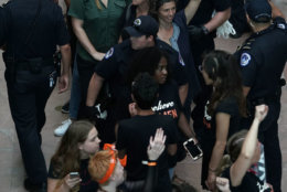WASHINGTON, DC - OCTOBER 04:  Comedian Amy Schumer, in green, is led away after she was arrested with other demonstrators during a protest against the confirmation of Supreme Court nominee Judge Brett Kavanaugh October 4, 2018 at the Hart Senate Office Building on Capitol Hill in Washington, DC. Senators had an opportunity to review a new FBI background investigation into accusations of sexual assault against Kavanaugh and Republican leaders are moving to have a vote on his confirmation this weekend. (Photo by Alex Wong/Getty Images)