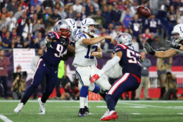 FOXBOROUGH, MA - OCTOBER 04:  Andrew Luck #12 of the Indianapolis Colts throws a pass during the second half against the New England Patriots at Gillette Stadium on October 4, 2018 in Foxborough, Massachusetts.  (Photo by Adam Glanzman/Getty Images)