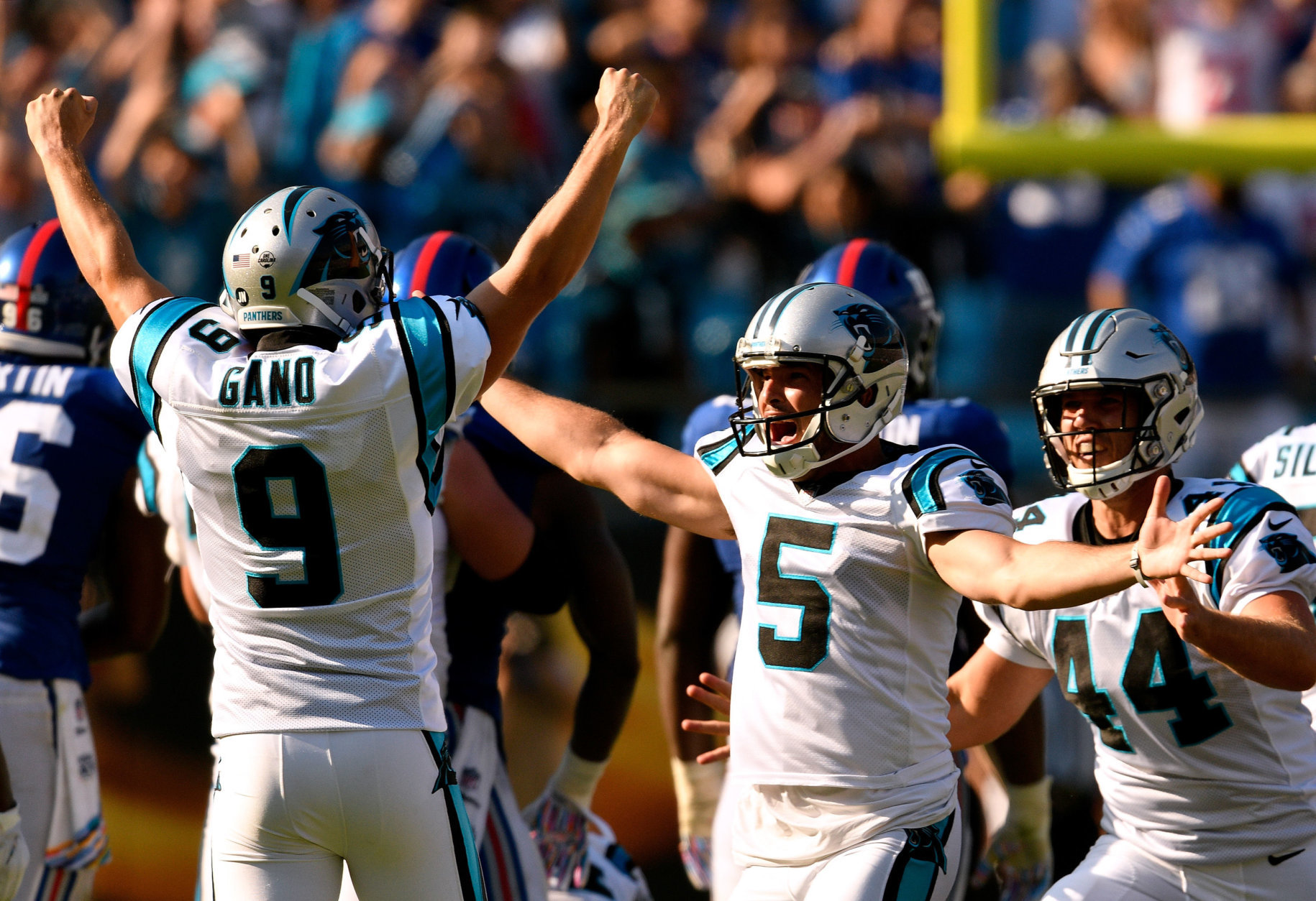 CHARLOTTE, NC - OCTOBER 07:  Kicker Graham Gano #9 celebrates with Michael Palardy #5 and J.J. Jansen #44 of the Carolina Panthers after his game-wining 63-yard field goal against the New York Giants during their game at Bank of America Stadium on October 7, 2018 in Charlotte, North Carolina. The Panthers won 33-31.  (Photo by Grant Halverson/Getty Images)