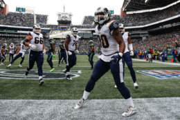 SEATTLE, WA - OCTOBER 07: Running Back Todd Gurley III #30 of the Los Angeles Rams celebrates a touchdown during the second half against the Seattle Seahawks at CenturyLink Field on October 7, 2018 in Seattle, Washington. (Photo by Otto Greule Jr/Getty Images)