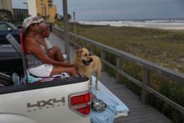 PANAMA CITY, FL - OCTOBER 09:  David Gage and Christal Gage and their dog, Bear, relax on the back of their pickup truck next to the ocean as they wait for the arrival of Hurricane Michael on October 9, 2018 in Parker, Florida. Michael, which strengthened to a Category 3 storm today with sustained winds of 120 mph, is expected to make landfall in the Florida Panhandle by Wednesday.   (Photo by Joe Raedle/Getty Images)