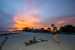 CRAWFORDVILLE, FL - OCTOBER 09: Tad West and Caitlyn Martin hang out on an empty Shell Point Beach as the sun set prior to the arrival of Hurricane Michael on October 9, 2018 in Crawfordville, Florida. Shell Point Beach is 30 miles south of Tallahassee. Florida. Hurricane Michael, which strengthened to a Category 3 storm today with sustained winds of 120 mph, is expected to make landfall in the Florida Panhandle by Wednesday. (Photo by Mark Wallheiser/Getty Images)