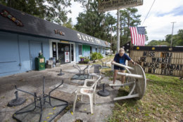 NEWPORT, FL - OCTOBER 09: Bar owner Dorothy White puts away outdoor furniture at Ouzts Too bar prior to the arrival of Hurricane Michael on October 9, 2018 in Newport, Florida. (Photo by Mark Wallheiser/Getty Images)