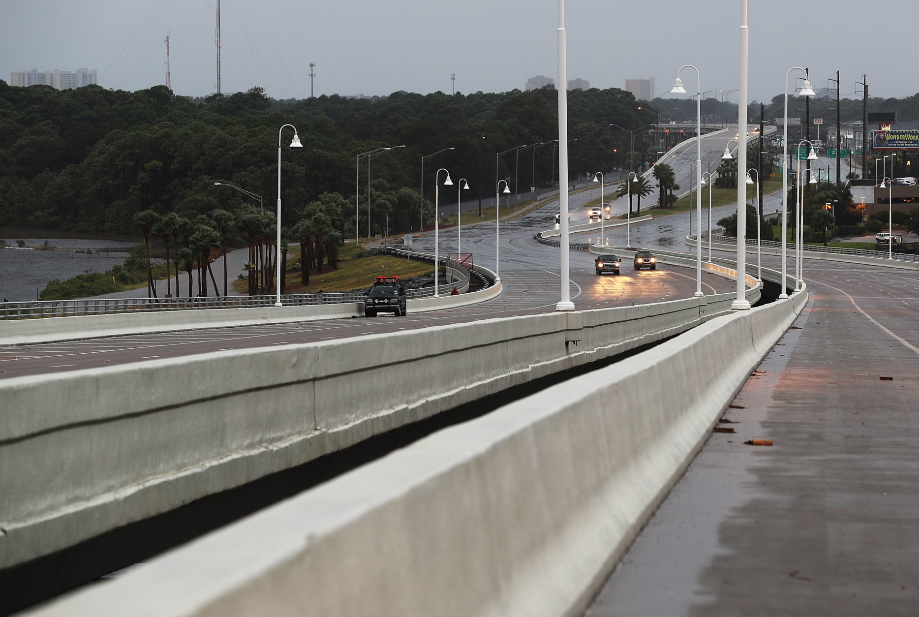 PANAMA CITY, FL - OCTOBER 10: A few cars drive along a bridge as the outerbands of  hurricane Michael arrive on October 10, 2018 in Panama City, Florida. The hurricane is forecast to hit the Florida Panhandle at a possible category 4 storm.  (Photo by Joe Raedle/Getty Images)