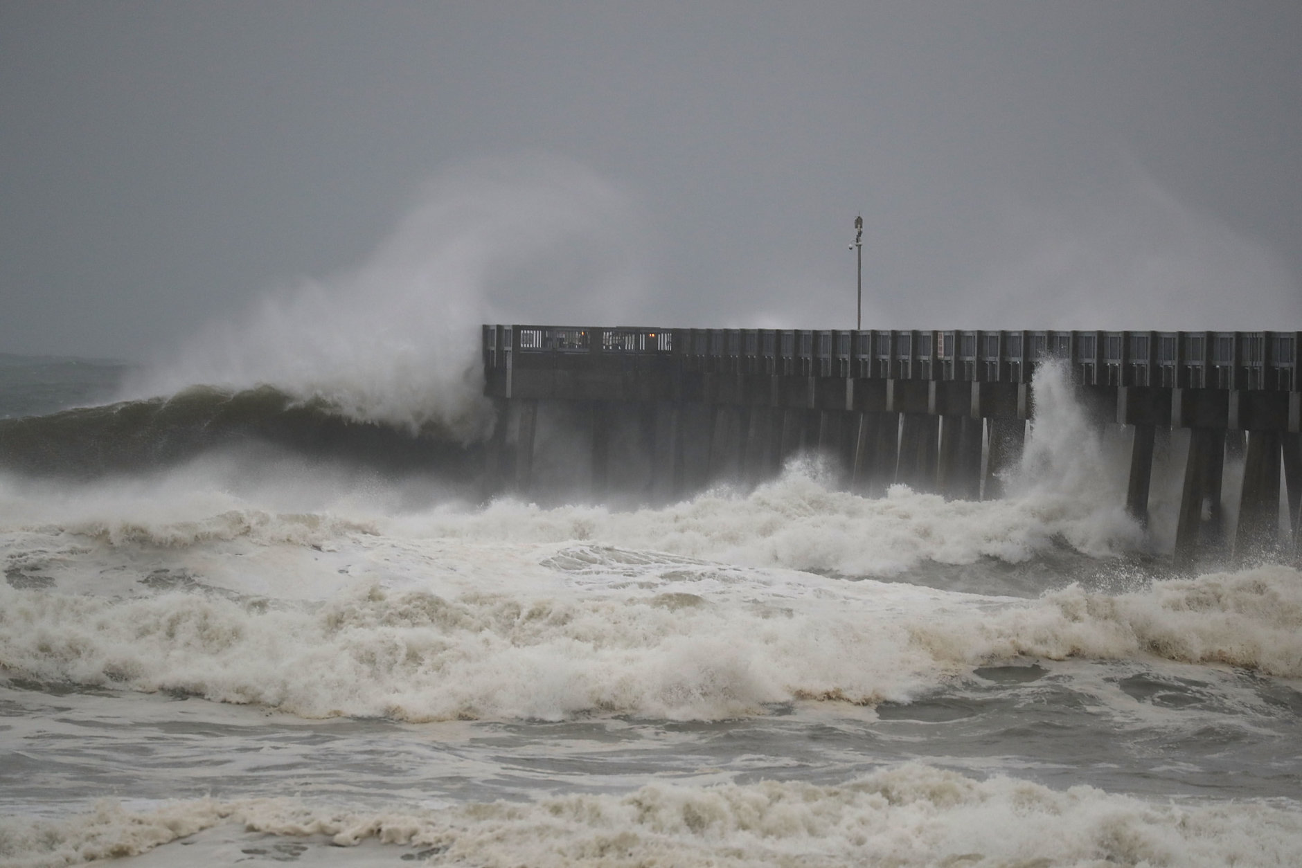 PANAMA CITY BEACH, FL - OCTOBER 10:  Waves crash along a pier as the outerbands of  hurricane Michael arrive on October 10, 2018 in Panama City Beach, Florida. The hurricane is forecast to hit the Florida Panhandle at a possible category 4 storm.  (Photo by Joe Raedle/Getty Images)