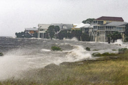 SHELL POINT BEACH, FL - OCTOBER 10: The storm surge and waves from Hurricane Michael batter the beachfront homes on October 10, 2018 in the Florida Panhandle community of Shell Point Beach, Florida. The hurricane is forecast to hit the Florida Panhandle at a possible category 4 storm.  (Photo by Mark Wallheiser/Getty Images)