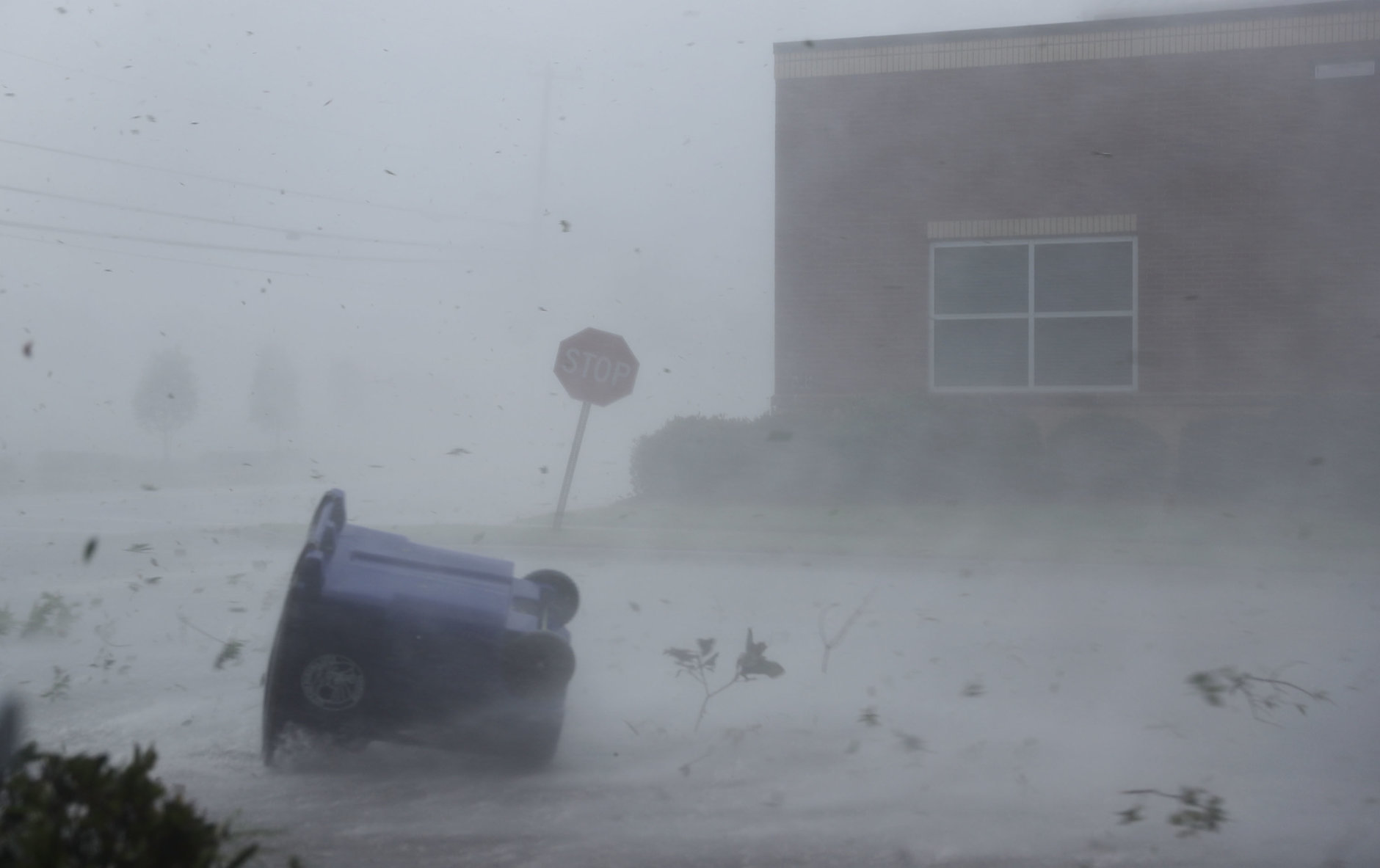 PANAMA CITY, FL - OCTOBER 10: A trash can and debris are blown down a street by Hurricane Michael on October 10, 2018 in Panama City, Florida. The hurricane made landfall on the Florida Panhandle as a category 4 storm.  (Photo by Joe Raedle/Getty Images)