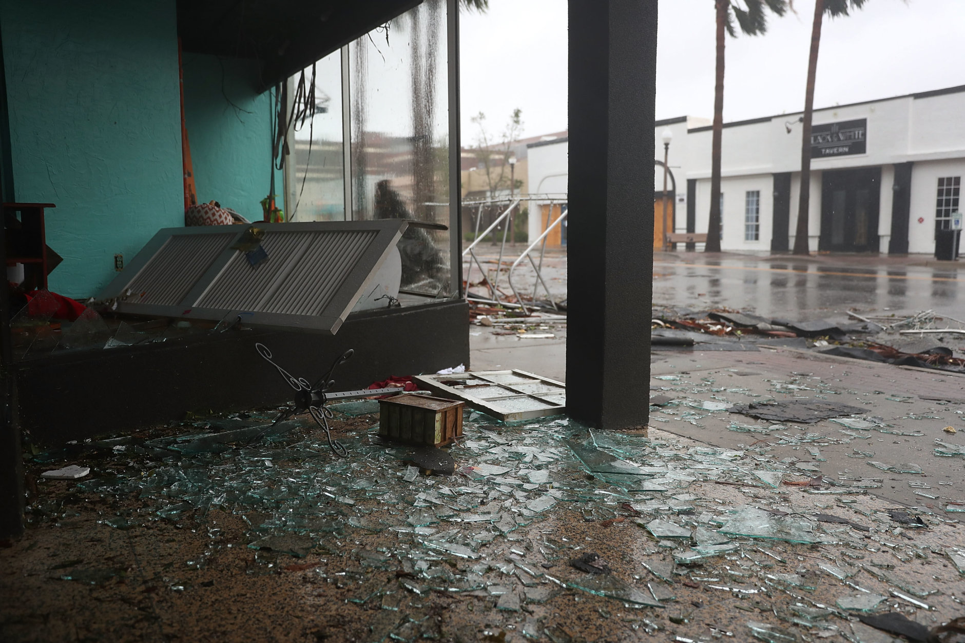 PANAMA CITY, FL - OCTOBER 10:  A stores windows are seen shattered as hurricane Michael passed through the downtown area on October 10, 2018 in Panama City, Florida. The hurricane hit the Florida Panhandle as a category 4 storm.  (Photo by Joe Raedle/Getty Images)