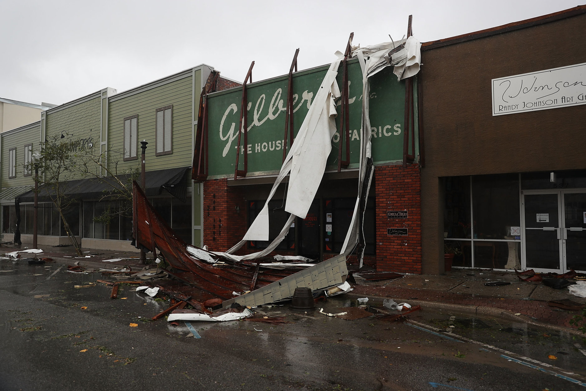 PANAMA CITY, FL - OCTOBER 10:  Broken awnings are seen after hurricane Michael passed through the downtown area on October 10, 2018 in Panama City, Florida. The hurricane hit the Florida Panhandle as a category 4 storm.  (Photo by Joe Raedle/Getty Images)