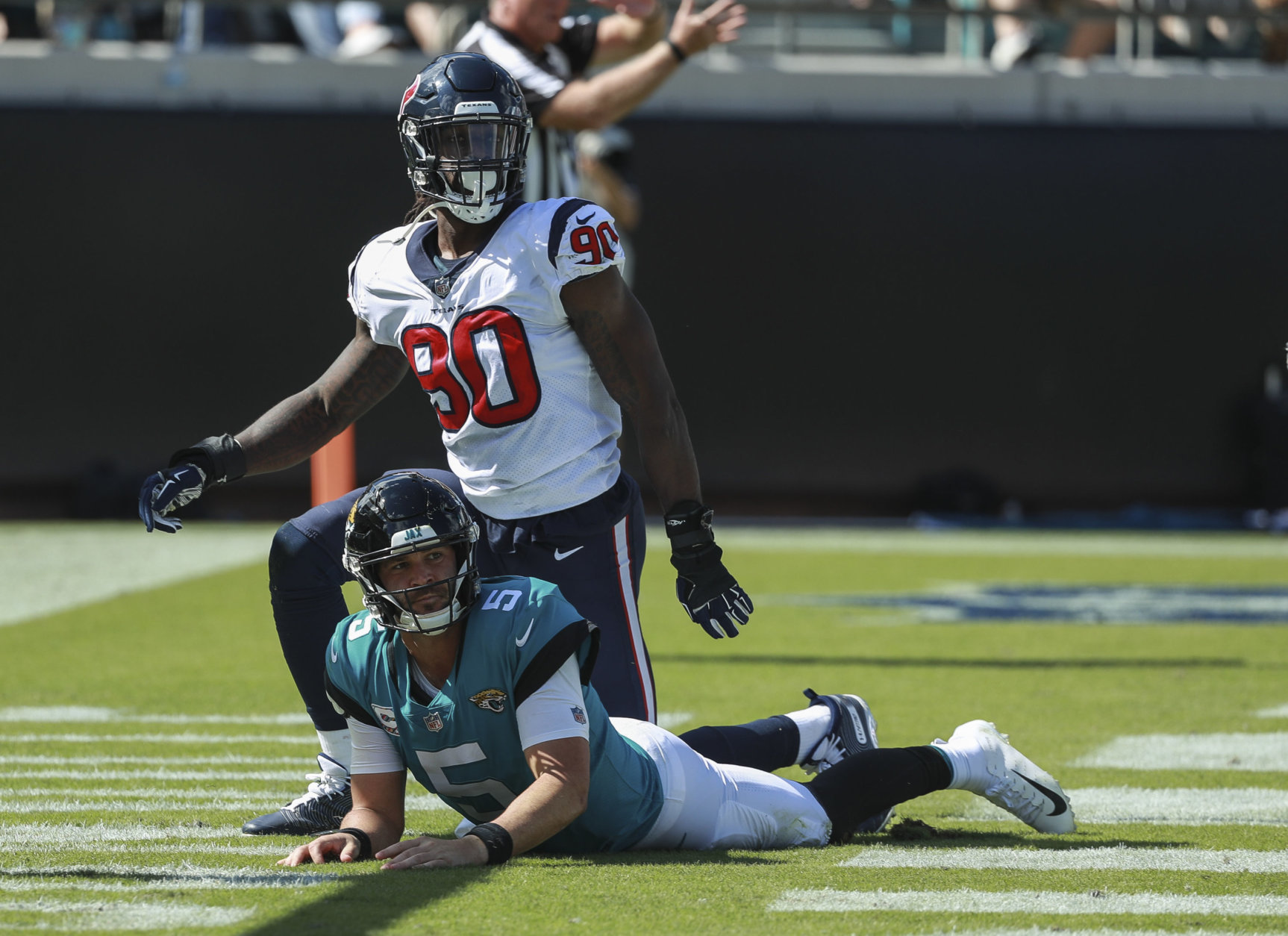 JACKSONVILLE, FL - OCTOBER 21: Blake Bortles #5 of the Jacksonville Jaguars looks up after being brought down by Jadeveon Clowney #90 of the Houston Texans during the second half at TIAA Bank Field on October 21, 2018 in Jacksonville, Florida.  (Photo by Scott Halleran/Getty Images)