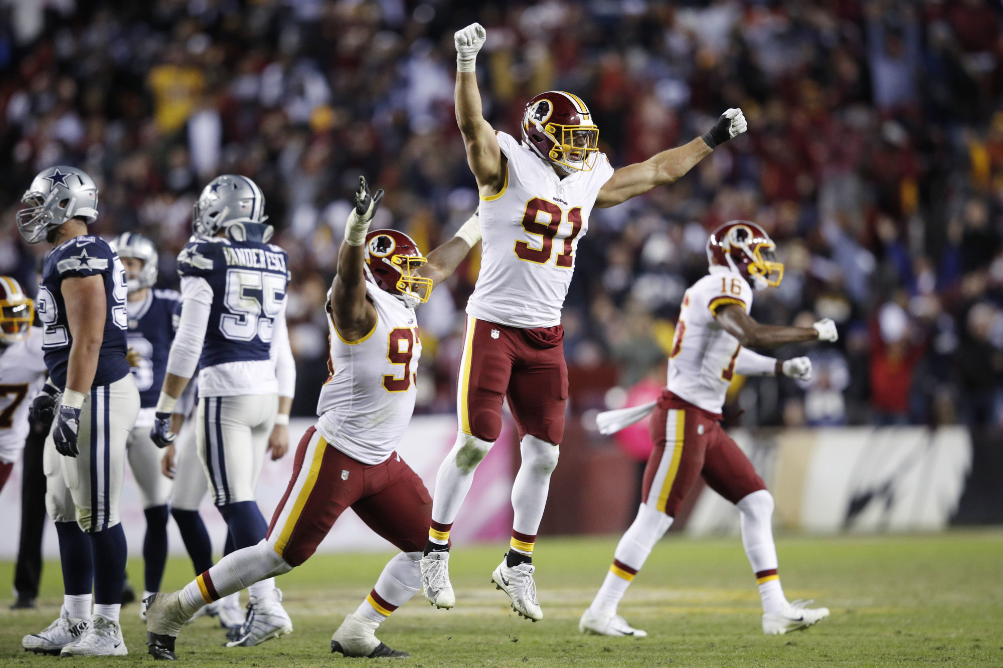 LANDOVER, MD - OCTOBER 21: Ryan Kerrigan #91 and Jonathan Allen #93 of the Washington Redskins react after a missed field goal by the Dallas Cowboys as time expired in the game at FedExField on October 21, 2018 in Landover, Maryland. The Redskins won 20-17. (Photo by Joe Robbins/Getty Images)