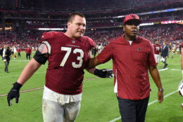 GLENDALE, AZ - OCTOBER 28:  Offensive coordinator Byron Leftwich and offensive guard John Wetzel #73 of the Arizona Cardinals walk off the field after the Cardinals beat the San Francisco 49ers 18-15 at State Farm Stadium on October 28, 2018 in Glendale, Arizona.  (Photo by Norm Hall/Getty Images)