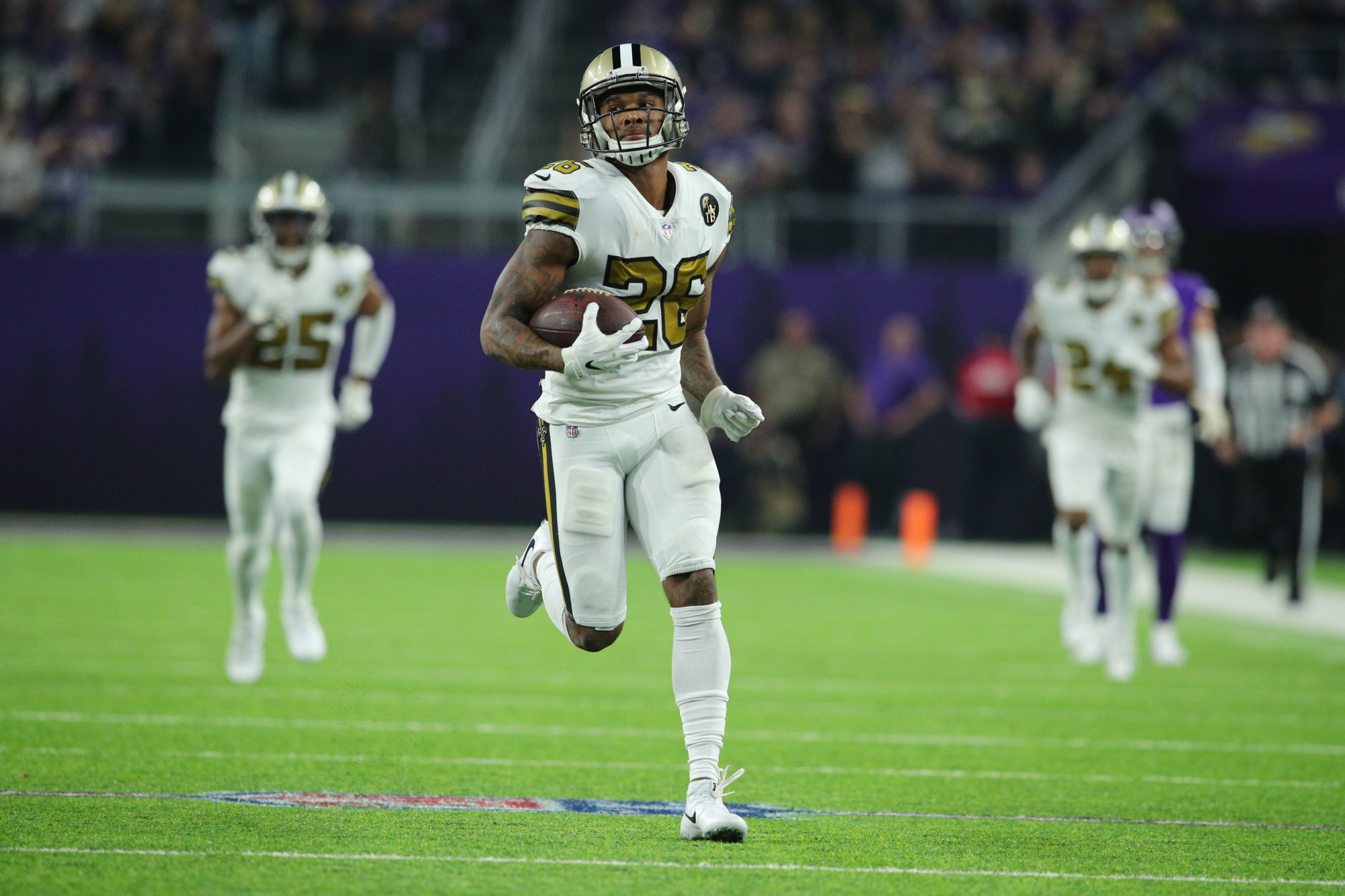 MINNEAPOLIS, MN - OCTOBER 28: P.J. Williams #26  of the New Orleans Saints carries the ball for a 45 yard touchdown after intercepting Kirk Cousins #8 of the Minnesota Vikings in the third quarter of the game at U.S. Bank Stadium on October 28, 2018 in Minneapolis, Minnesota. (Photo by Adam Bettcher/Getty Images)