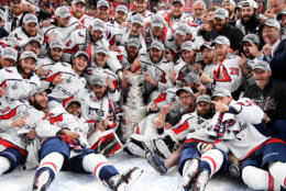 LAS VEGAS, NV - JUNE 07:  Alex Ovechkin #8 of the Washington Capitals poses with his teammates for the team photo after their 4-3 win over the Vegas Golden Knights to win the Stanley Cup in Game Five of the 2018 NHL Stanley Cup Final at T-Mobile Arena on June 7, 2018 in Las Vegas, Nevada.  (Photo by Harry How/Getty Images)
