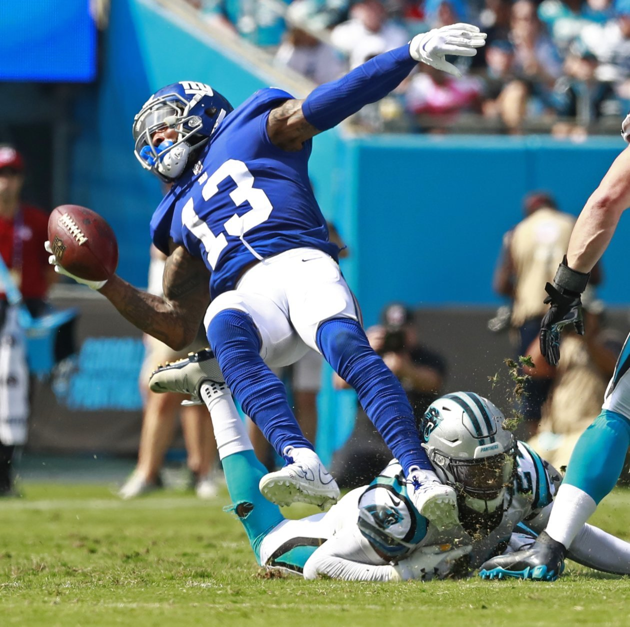 New York Giants' Odell Beckham (13) is tackled by Carolina Panthers' James Bradberry (24) in the first half of an NFL football game in Charlotte, N.C., Sunday, Oct. 7, 2018. (AP Photo/Jason E. Miczek)