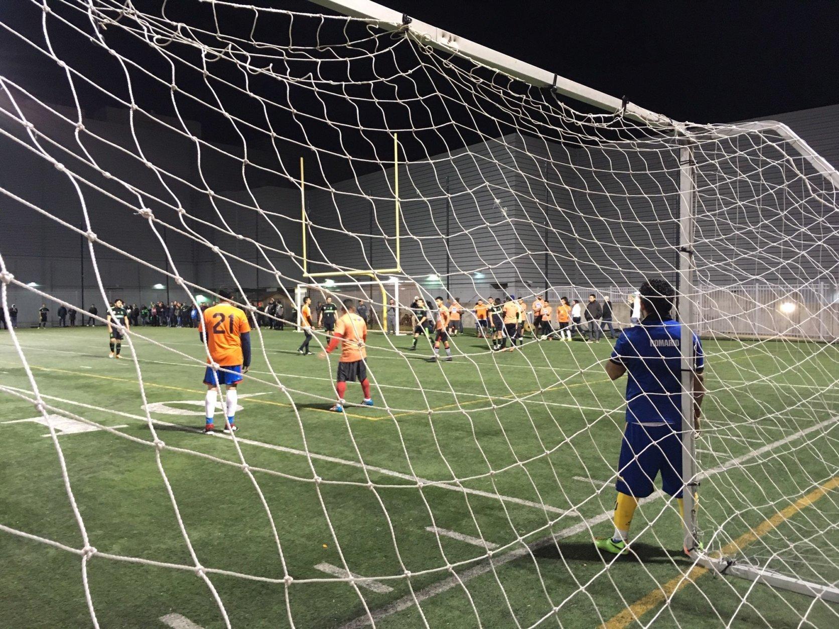 Team Oyamel awaits a free kick in the annual ThinkFoodGroup Copa soccer tournament between chef José Andrés's D.C. area restaurants. (WTOP/Noah Frank)