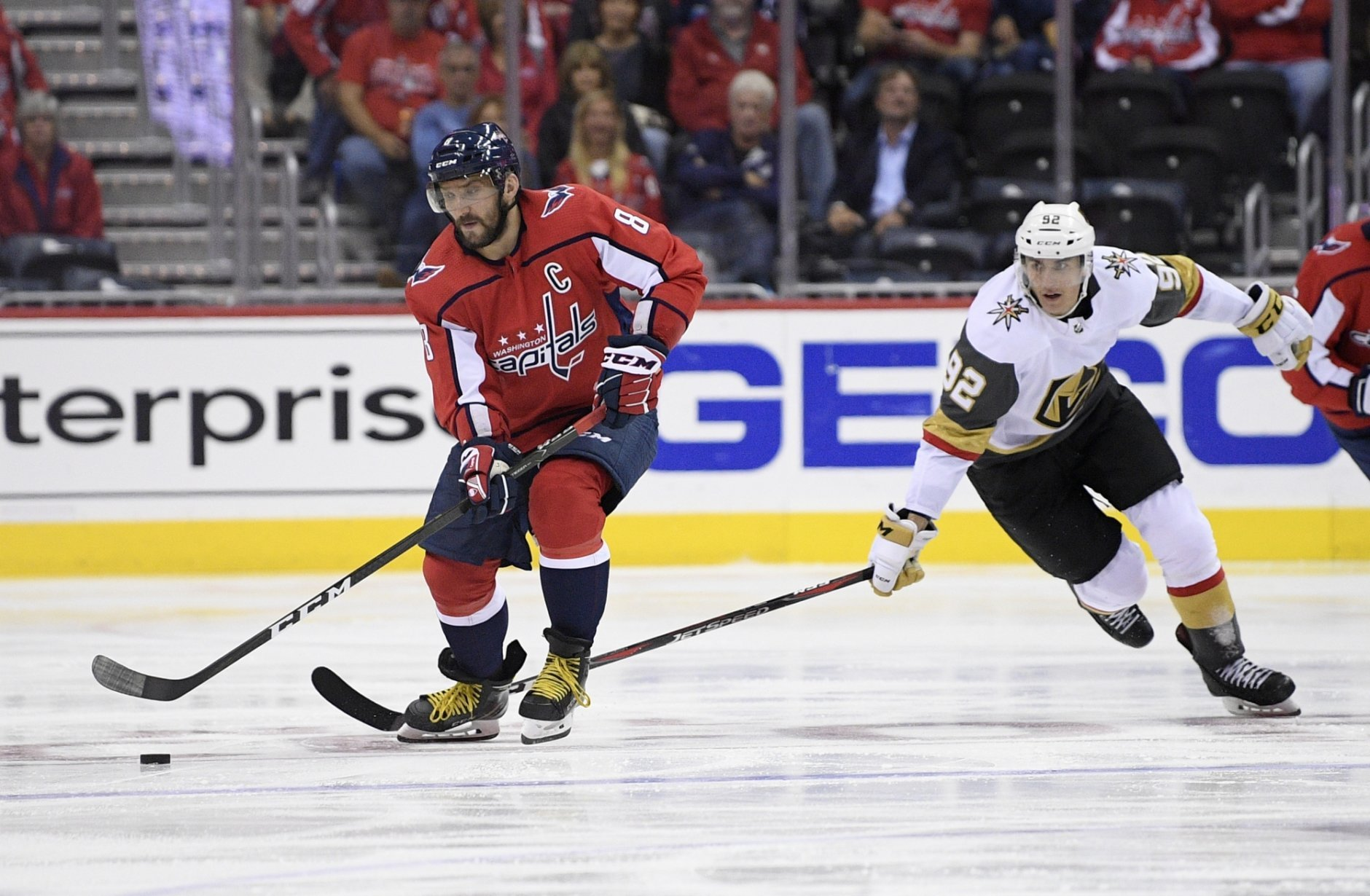 Washington Capitals left wing Alex Ovechkin (8), of Russia, skates with the puck against Vegas Golden Knights left wing Tomas Nosek (92) during the second period of an NHL hockey game Wednesday, Oct. 10, 2018, in Washington. (AP Photo/Nick Wass)