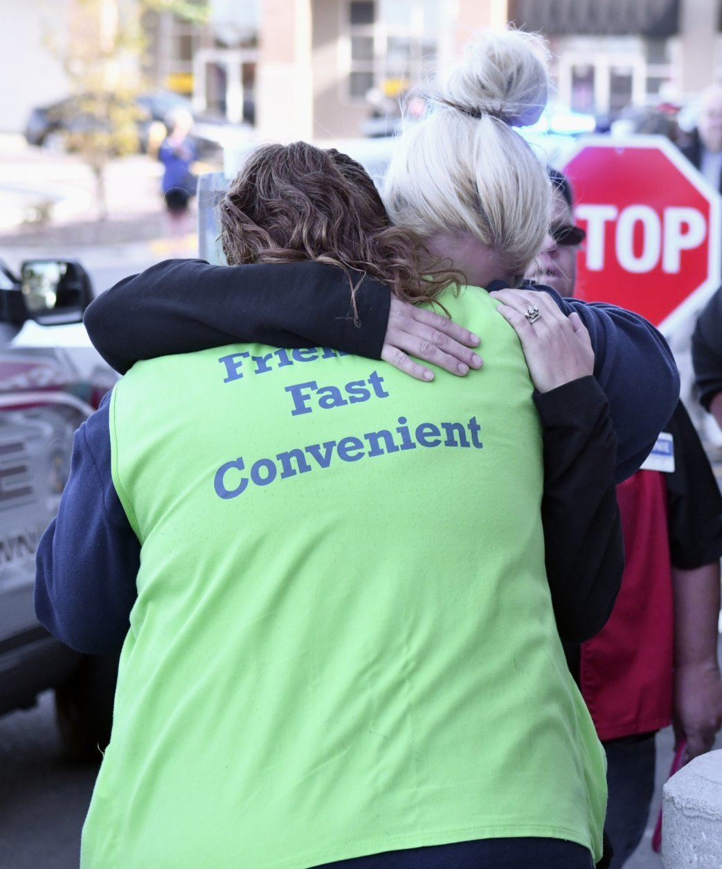 Kroger employees hug each other in the aftermath of shooting that left two people dead and a suspect in custody, Wednesday, Oct. 24, 2018, in Jeffersontown, Ky. A man fatally shot another man inside a Kroger grocery store, shot and killed a woman in the parking lot, and then exchanged fire with an armed bystander who intervened before he fled the scene on the outskirts of Louisville, Kentucky, on Wednesday, police said. He was captured shortly afterward. (AP Photo/Timothy D. Easley)