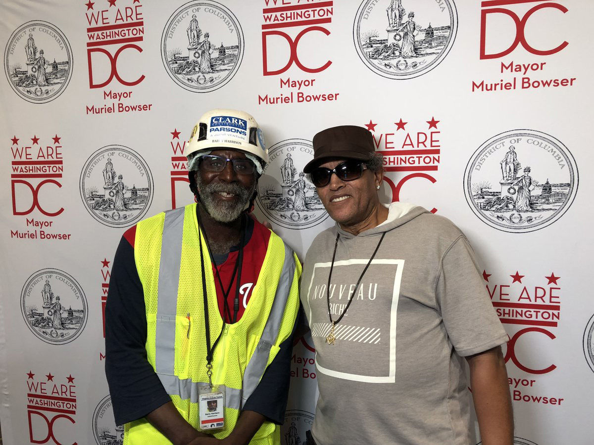"""Barry Harrison, of Clark Construction, helped tear down a fence and build and widen a road for DC Fire equipment at the Arthur Capper Senior Apartments fire. """"It was gratifying just to be able to help them,"""" Harrison said. He met resident Robert Sparrow while working nearby. (WTOP/Kristi King)"""