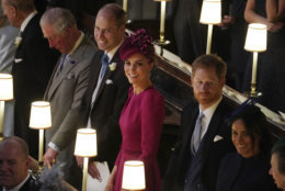 Britain's Prince Charles, Prince William, Kate, Duchess of Cambridge, Britain's Prince Harry and Meghan, Duchess of Sussex, from left, attend the wedding of Princess Eugenie of York and Jack Brooksbank in St George's Chapel, Windsor Castle, near London, England, Friday Oct. 12, 2018. (Owen Humphreys, Pool via AP)