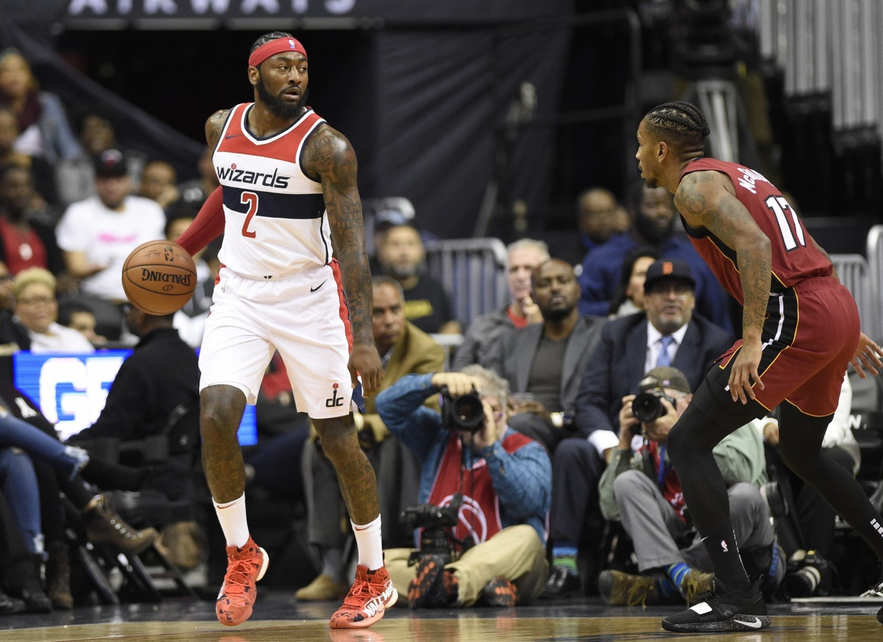Washington Wizards guard John Wall (2) dribbles the ball against Miami Heat guard Rodney McGruder (17) during the first half of an NBA basketball game, Thursday, Oct. 18, 2018, in Washington. (AP Photo/Nick Wass)