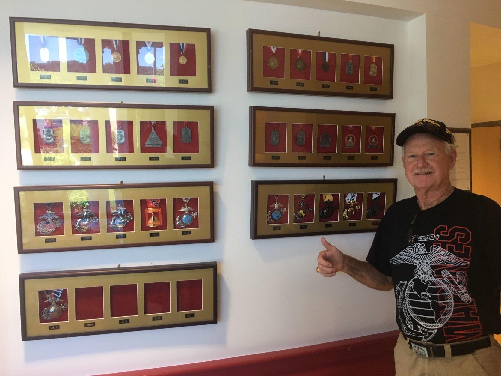 "Steve Bozeman poses with ""finishers medal"" of the Marine Corps Marathon at Marine Corps Base Quantico. (Courtesy Steve Bozeman)"