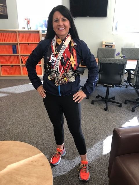 BethAnn Telford has 15 medals from previous Marine Corps Marathons. (WTOP/Melissa Howell)
