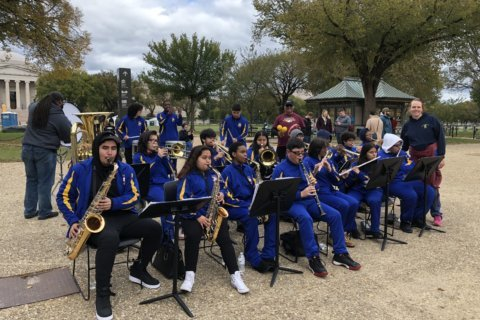 Local marching band gives back by playing to inspire marathon runners