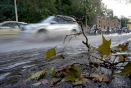 """Traffic passes in a partially flooded street a day after strong winds and rain hit the city, in Rome, Tuesday, Oct. 30, 2018. The national Civil Protection Agency has issued red and orange alerts -- meaning possible """"loss of life"""" from landslides, floods, and infrastructural damage -- due to an Atlantic storm system that has brought torrential rains and hail, electrical storms, powerful winds and high seas to Italy from North to South. (AP Photo/Andrew Medichini)"""