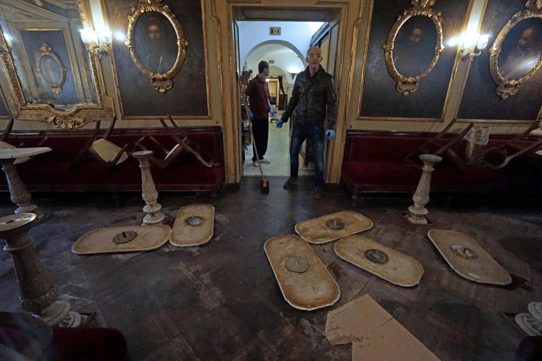 Upturned chairs and unmounted table tops lie on the floor inside the historic Caffe Florian, in San Marco square, in Venice, Italy, Tuesday, Oct.30 2018. High winds created an exceptional tide in Venice on Monday, covering three-quarters of the city for the first time in a decade. Water levels were forecast Tuesday at 110 centimeters (43.3 inches), flooding 12 percent of the famed lagoon city. (Andrea Merola/ANSA via AP)