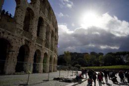 """The sun shines through clouds by the ancient Colosseum a day after strong winds and rain hit the city, in Rome, Tuesday, Oct. 30, 2018. The national Civil Protection Agency has issued red and orange alerts -- meaning possible """"loss of life"""" from landslides, floods, and infrastructural damage -- due to an Atlantic storm system that has brought torrential rains and hail, electrical storms, powerful winds and high seas to Italy from North to South. (AP Photo/Andrew Medichini)"""