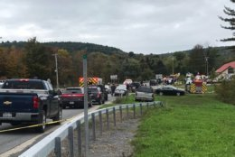 In this Saturday, Oct. 6, 2018 photo, emergency personnel respond to the scene of a deadly crash in Schoharie, N.Y. (WTEN via AP)