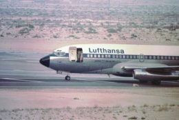 Two unidentified persons stand in the doorway of a hijacked Lufthansa 737 jet parked at Dubai airport Oct. 17, 1977. The jet was hijacked by West German terrorists with 91 hostages aboard. The plane later flew to Mogadishu in Somalia where it was freed in an Entabbe-like attack by West German troops.  (AP Photo)